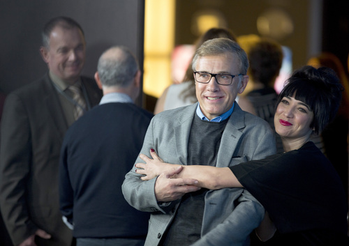 Jury member Mitra Farahani, right, embraces fellow jury member Christoph Waltz as they arrive for the jury photo call at the International Film Festival Berlinale, in Berlin, Thursday, Feb. 6, 2014. (AP Photo/Axel Schmidt)