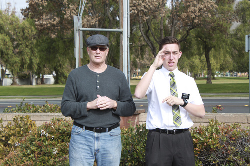 | Courtesy Chad Le Beau Caption: Elder Chad Le Beau, a Mormon missionary serving in the San Jose LDS mission, helps interpret for Paul Kalff at the California School for the Deaf.