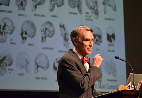 "TV's ""Science Guy"" Bill Nye stand speaks during a debate on evolution with Creation Museum head Ken Ham, Tuesday, Feb. 4, 2014, at the Petersburg, Ky. museum. Ham believes the Earth was created 6,000 years ago by God and is told strictly through the Bible. Nye says he is worried the U.S. will not move forward if creationism is taught to children. (AP Photo/Dylan Lovan)"