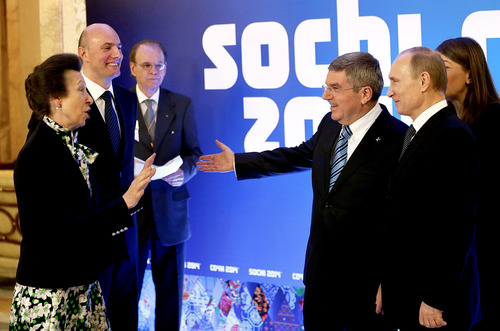 International Olympic Committee member Princess Anne of Great Britain, left, greets Russian President Vladimir Putin, right, IOC President Thomas Bach, second from right, and Sochi 2014 Olympics President Dmitry Chernyshenko, second from left, at an event welcoming IOC members ahead of the upcoming 2014 Winter Olympics at the Rus Hotel, Tuesday, Feb. 4, 2014, in Sochi, Russia. (AP Photo/David Goldman, Pool)