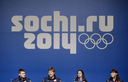 U.S. speedskaters Joey Mantia, from left, Brian Hansen, Brittany Bowe and Heather Richardson wait for a 2014 Winter Olympics news conference to begin, Thursday, Feb. 6, 2014, in Sochi, Russia. (AP Photo/Patrick Semansky)