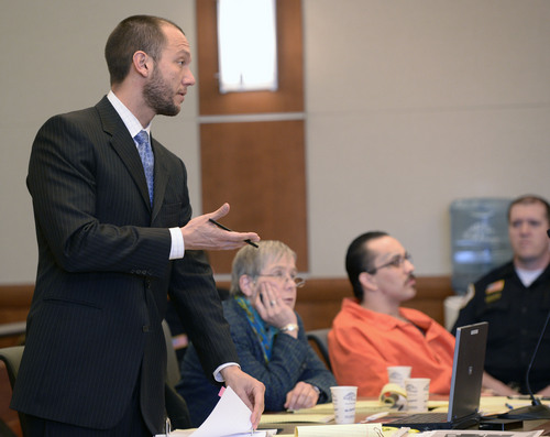 Al Hartmann  |  The Salt Lake Tribune  Matthew Barraza, defense lawyer for David Fresques, questions witness in Judge Mark Kouris' court in West Jordan Thursday February 6. Fresques is charged with aggravated murder for allegedly killing three people at a Midvale home in February 2013.