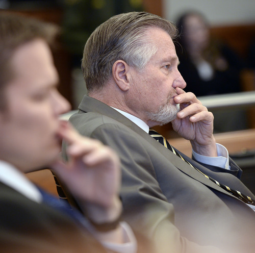 Al Hartmann  |  The Salt Lake Tribune  Prosecuter Robert Stott listens to witness testimony in David Fresques preliminaryhearing in West Jordan Thursday February 6.  Fresques is charged with aggravated murder for allegedly killing three people at a Midvale home in February 2013.