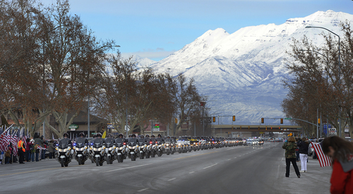 Scott Sommerdorf   |  The Salt Lake Tribune Motorcycle units led the procession down Spanish Fork's Main Street as Utah County Sheriff's Sgt. Cory Wride's procession passes, Wednesday, Feb. 5, 2014.