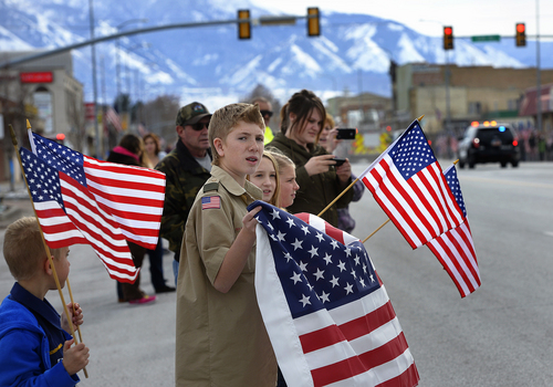 Scott Sommerdorf   |  The Salt Lake Tribune People line the route along Spanish Fork's Main Street as Utah County Sheriff's Sgt. Cory Wride's procession passes, Wednesday, Feb. 5, 2014.
