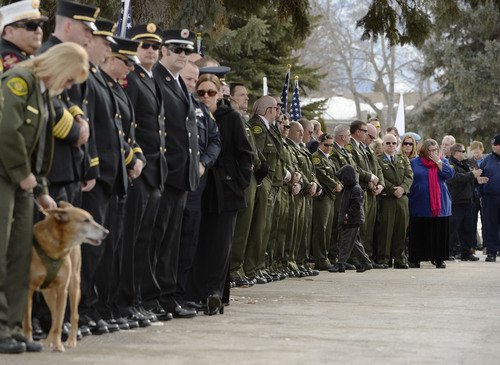 Steve Griffin  |  The Salt Lake Tribune   Law enforcement officers from across the state and the public line a road leading to the grave for slain Utah County Sheriff's Sgt. Cory Wride during interment services at the Spanish Fork Cemetery, in Spanish Fork, Utah Wednesday, February 5, 2014.