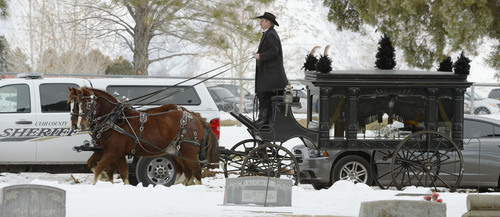 Steve Griffin  |  The Salt Lake Tribune   A horse drawn hearse leaves the Spanish Fork Cemetery after delivering the body of slain Utah County Sheriff's Sgt. Cory Wride during interment services in Spanish Fork, Utah Wednesday, February 5, 2014.