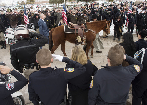 Steve Griffin  |  The Salt Lake Tribune   A horse carries the boats and hat of slain Utah County Sheriff's Sgt. Cory Wride during interment services at the Spanish Fork Cemetery, in Spanish Fork, Utah Wednesday, February 5, 2014.