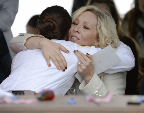 Steve Griffin  |  The Salt Lake Tribune   Nanette Wride, wife of slain Utah County Sheriff's Sgt. Cory Wride, hugs a law enforcement officer during interment services at the Spanish Fork Cemetery, in Spanish Fork, Utah Wednesday, February 5, 2014.