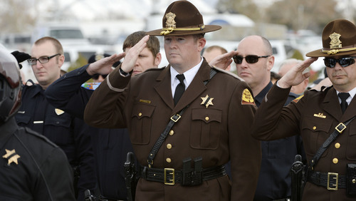 Steve Griffin  |  The Salt Lake Tribune   Law enforcement officers from across the state and the public attend interment services for slain Utah County Sheriff's Sgt. Cory Wride at the Spanish Fork Cemetery, in Spanish Fork, Utah Wednesday, February 5, 2014.