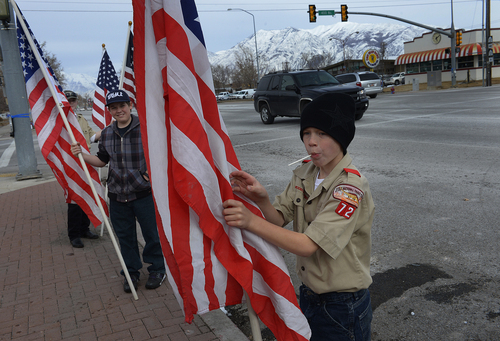 Scott Sommerdorf   |  The Salt Lake Tribune Boy Scouts from Troop 72 in Cory Wride's ward, line the route along Spanish Fork's Main Street as they wait for the slain sheriff's deputy's funeral cortege to pass, Wednesday, Feb. 5, 2014.