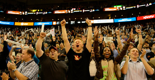 Trent Nelson  |  The Salt Lake Tribune Jazz fans celebrate as the Utah Jazz defeat the New Orleans Pelicans, NBA basketball at EnergySolutions Arena in Salt Lake City, Wednesday November 13, 2013.