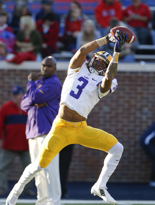 LSU wide receiver Odell Beckham Jr. (3) catches a pass during pregame drills before playing Mississippi in their NCAA college football game at Vaught-Hemingway Stadium in Oxford, Miss., Saturday, Oct. 19, 2013. Mississippi won 27-24. (AP Photo/Rogelio V. Solis)
