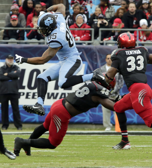 North Carolina's Eric Ebron (85) leaps over Cincinnati's Jeff Luc (48) during the first half of the Belk Bowl NCAA college football game, Saturday, Dec. 28, 2013, in Charlotte, N.C. (AP Photo/Nell Redmond)