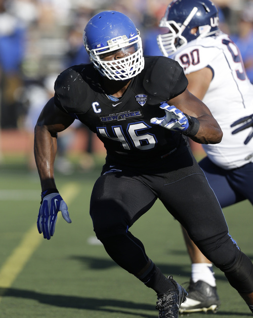 Buffalo linebacker Khalil Mack (46) runs on the field during the first half of an NCAA football game against the Connecticut on Saturday, Sept. 28, 2013, in Buffalo, N.Y. (AP Photo/Mike Groll)
