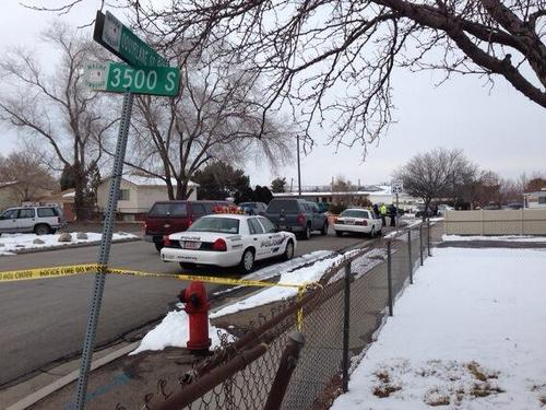 Jim Dalrymple II  |  The Salt Lake Tribune  Access to a Magna neighborhood is blocked after a man reportedly shot at police after trying to cash or deposit a forged or bad check on Thursday, Feb. 6, 2014.