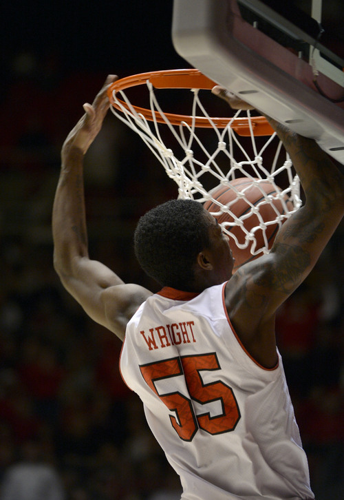 Francisco Kjolseth  |  The Salt Lake Tribune Utah Utes guard Delon Wright (55) steals a ball on his way to a slam dunk against Washington in game action at the Huntsman Center on the University of Utah campus on Thursday, Feb. 6, 2014.