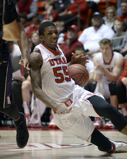Francisco Kjolseth  |  The Salt Lake Tribune Utah Utes guard Delon Wright (55) looses his footing against Washington at the Huntsman Center on the University of Utah campus on Thursday, Feb. 6, 2014.