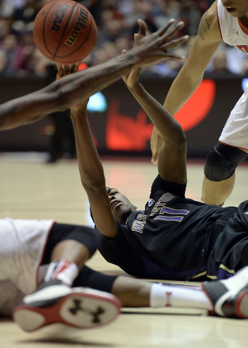 Francisco Kjolseth  |  The Salt Lake Tribune Washington Huskies guard Mike Anderson (11) tries to get rid of the ball past Utah in game action at the Huntsman Center on the University of Utah campus on Thursday, Feb. 6, 2014.