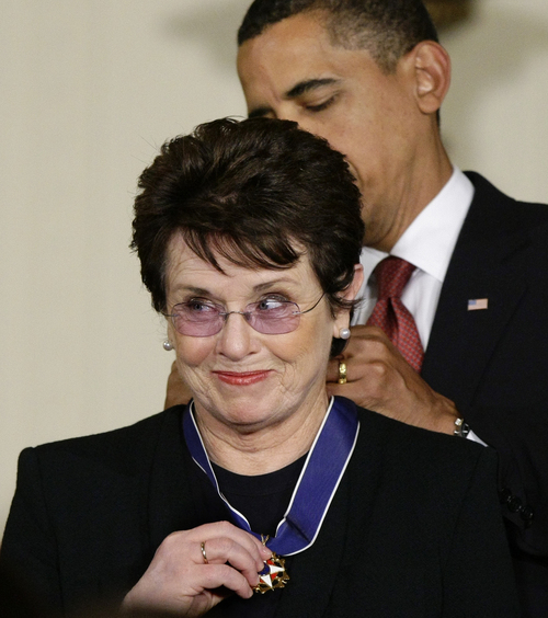 """FILE - In this Aug. 12, 2009 file photo, President Barack Obama presents the 2009 Presidential Medal of Freedom to Billie Jean King, known for winning the famous """"Battle of the Sexes"""" tennis match, and championing gender equality issues, during ceremonies at the White House in Washington. Japanese Prime Minister Shinzo Abe and his Chinese counterpart Xi Jinping appear not to be bothered by the international ruckus over Russia's law restricting gay rights. Unlike President Barack Obama, who pointedly declined to attend the Winter Olympics, the leaders of the world's second and third largest economies — where gay rights are not a hot-button political issue — are going to Sochi. King, who was selected to help lead the U.S. delegation to the Games, has been outspoken in her opposition to Russia's anti-gay law. (AP Photo/J. Scott Applewhite, File)"""