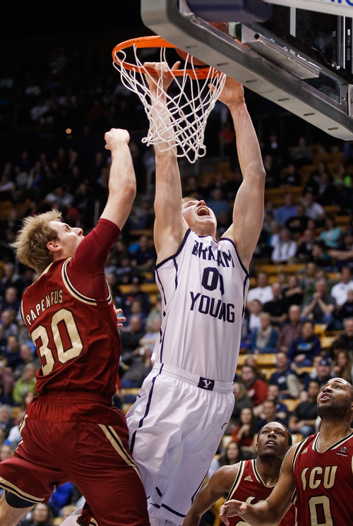 BYU's Eric Mika, right, dunks the ball past Santa Clara's Andrew Papenfus, left, during the NCAA men's basketball game between BYU and Santa Clara at the Marriott Center in Provo, Utah on Thursday, Feb. 6, 2014. (AP Photo/The Daily Herald, Spenser Heaps)