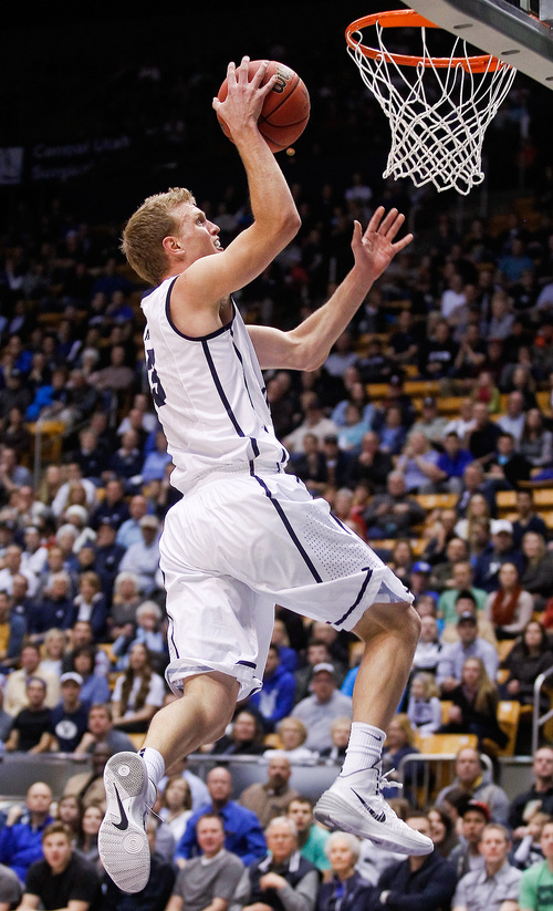 BYU's Tyler Haws lays it up during the NCAA men's basketball game between BYU and Santa Clara at the Marriott Center in Provo, Utah on Thursday, Feb. 6, 2014.  (AP Photo/The Daily Herald, Spenser Heaps)