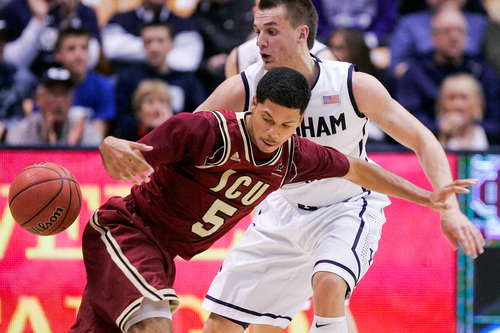 Santa Clara's Jalen Richard, left, looses the ball as he tries to drive past BYU's Kyle Collinsworth during the NCAA men's basketball game between BYU and Santa Clara at the Marriott Center in Provo, Utah on Thursday, Feb. 6, 2014. (AP Photo/The Daily Herald, Spenser Heaps)
