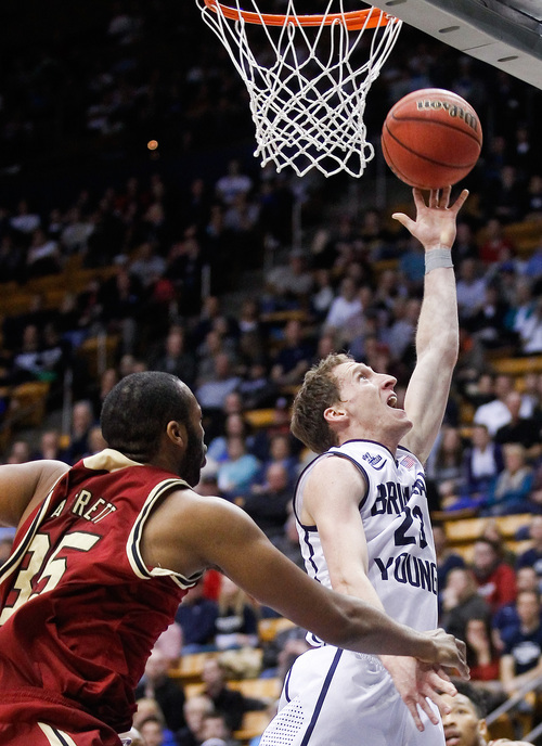 BYU's Skyler Halford, right, lays it up over Santa Clara's Robert Garrett, left, during the NCAA men's basketball game between BYU and Santa Clara at the Marriott Center in Provo, Utah on Thursday, Feb. 6, 2014. (AP Photo/The Daily Herald, Spenser Heaps)