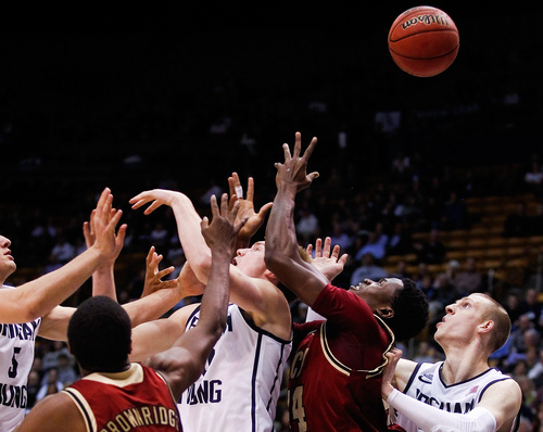Players scramble for a rebound during the NCAA men's basketball game between BYU and Santa Clara at the Marriott Center in Provo, Utah on Thursday, Feb. 6, 2014. (AP Photo/The Daily Herald, Spenser Heaps)