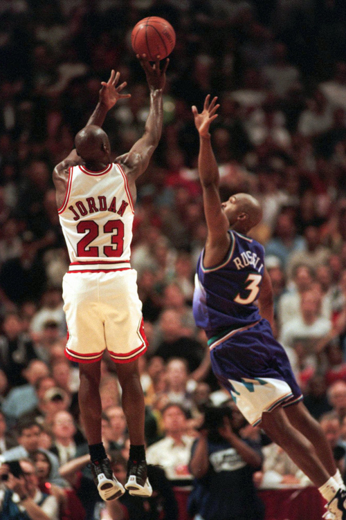 low priced af60a 6a508 Tribune file photo IThe Chicago Bulls  Michael Jordan puts up the  game-winning shot