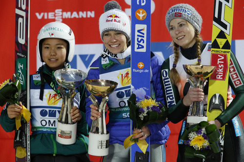 From left, Sara Takanashi of Japan,who finished third,  winner, Sarah Hendrickson of the US, and Anette Sagen of Norway, who finished in second place, on the podium after the Women's Normal Hill Individual event at the FIS Ski jumping Cup in Sochi, Russia, Saturday, Dec. 8, 2012. (AP Photo/Dmitry Lovetsky)