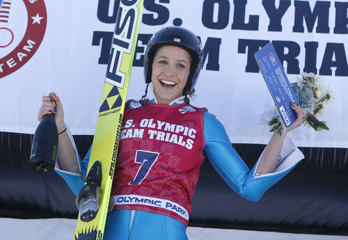 First-place finisher Jessica Jerome reacts on the podium after women's ski jumping event  at the U.S. Olympic trials in Park City, Utah, Sunday, Dec. 29, 2013. (AP Photo/Jim Urquhart)