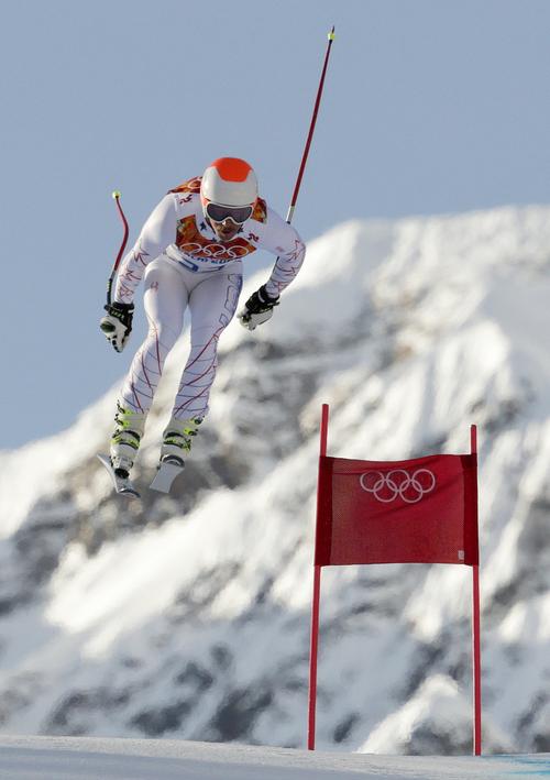 United States' Jared Goldberg makes a jump during a men's downhill training run for the Sochi 2014 Winter Olympics, Friday, Feb. 7, 2014, in Krasnaya Polyana, Russia. (AP Photo/Charles Krupa)