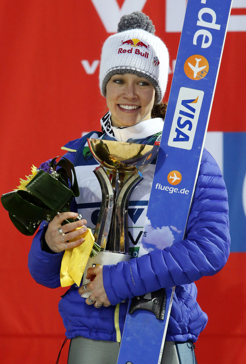 Sarah Hendrickson of the US celebrates her first place in the Women's Normal Hill Individual event at the FIS Ski jumping Cup in Sochi, Russia, Saturday, Dec. 8, 2012. (AP Photo/Dmitry Lovetsky)