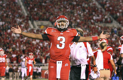 Scott Sommerdorf  |  The Salt Lake Tribune After directing the tying drive and running in the two-point conversion, Ute QB Brian Johnson accepts the crowd's praise. Utah wins 31-28 on a last second FG by K Louie Sakoda on October 2, 2008.