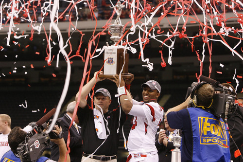 Scott Sommerdorf  |  The Salt Lake Tribune Utah head coach Kyle Whittingham  and Utah quarterback Brian Johnson (3) hold their trophy aloft after the Utes defeated Alabama in the 75th annual Sugar Bowl in New Orleans, Friday, January 2, 2009.