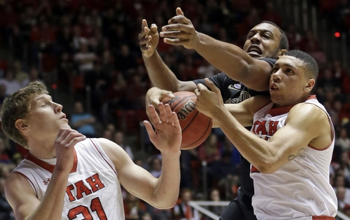 Utah's Jordan Loveridge, right,  pulls down a rebound while his teammate Dallin Bachynski, left, looks on while Washington's Perris Blackwell, center, reaches in the second half of an NCAA college basketball game Thursday, Feb. 6, 2014, in Salt Lake City. Utah won 78-69. (AP Photo/Rick Bowmer)