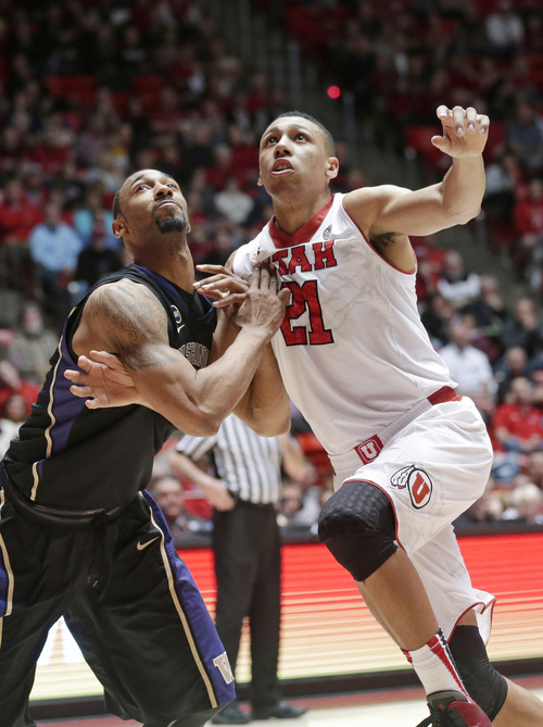 Washington's Desmond Simmons, left, and Utah's Jordan Loveridge (21) battle under the boards in the first half of an NCAA college basketball game Thursday, Feb. 6, 2014, in Salt Lake City. (AP Photo/Rick Bowmer)