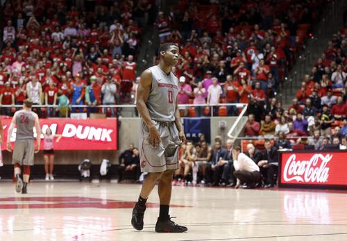 Washington State guard Ike Iroegbu reacts after a play during the second half of an NCAA college basketball game against Utah in Salt Lake City, Saturday, Feb. 8, 2014. Utah won 81-63. (AP Photo/Jim Urquhart)