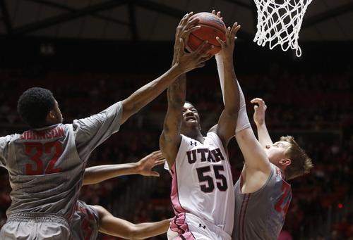 Utah guard Delon Wright (55) shoots as Washington State guard Que Johnson (32) and forward Josh Hawkinson (24) defend during the second half of an NCAA college basketball game in Salt Lake City, Saturday, Feb. 8, 2014. Utah won 81-63. (AP Photo/Jim Urquhart)