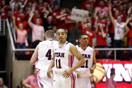 Utah guard Brandon Taylor (11) reacts after a play against Washington State during the second half of an NCAA college basketball game in Salt Lake City, Saturday, Feb. 8, 2014. Utah won 81-63. (AP Photo/Jim Urquhart)
