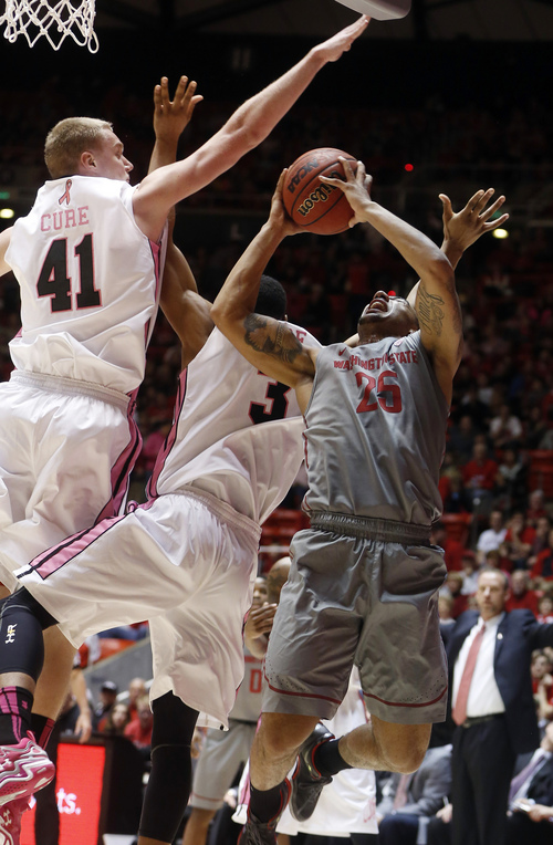 Washington State guard DaVonte Lacy (25) attempts a shot while defended by Utah forward Jeremy Olsen (41) and guard Princeton Onwas (3) during the first half of an NCAA college basketball game in Salt Lake City, Saturday, Feb. 8, 2014. (AP Photo/Jim Urquhart)