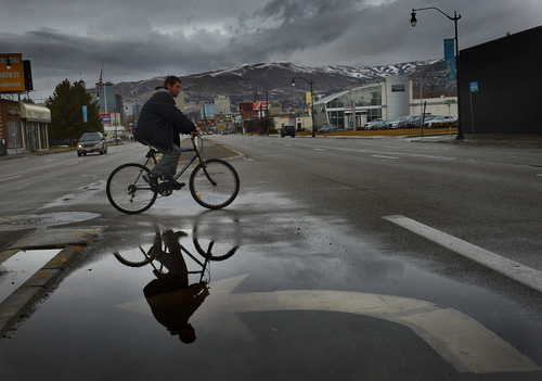 Scott Sommerdorf   |  The Salt Lake Tribune Rain pooled in turn lanes on State Street, Sunday, Feb. 9, 2014.
