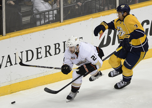 Anaheim Ducks right wing Kyle Palmieri (21) maneuvers past Nashville Predators defenseman Seth Jones (3) attempting to get control of the puck in the first period of an NHL hockey game on Saturday, Feb. 8, 2014, in Nashville, Tenn. (AP Photo/Mark Zaleski)