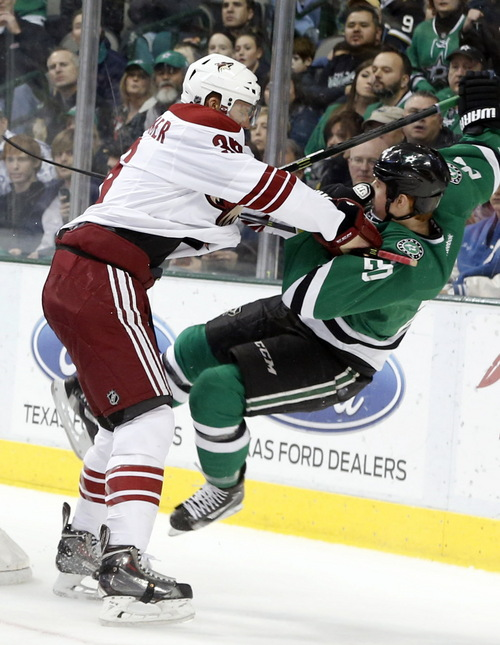 Phoenix Coyotes left wing Rob Klinkhammer (36) pushes Dallas Stars center Cody Eakin (20) during the first period during of an NHL hockey game in Dallas, Saturday, Feb. 8, 2014. (AP Photo/The Dallas Morning News, Vernon Bryant)  MANDATORY CREDIT; MAGS OUT; TV OUT; INTERNET USE BY AP MEMBERS ONLY; NO SALES