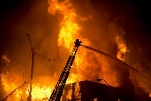 Lennie Mahler  |  The Salt Lake Tribune Firefighters battle a four-alarm fire near downtown Salt Lake City last Sunday.
