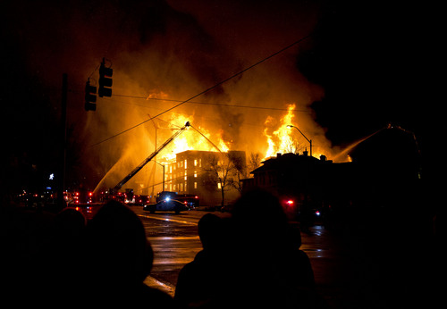 Lennie Mahler  |  The Salt Lake Tribune Bystanders watch as firefighters battle a four-alarm fire near downtown Salt Lake City, Sunday, Feb. 9, 2014.