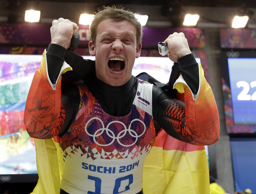 Felix Loch of Germany celebrates after he crossed the finish area to win the gold medal during the men's singles luge final at the 2014 Winter Olympics, Sunday, Feb. 9, 2014, in Krasnaya Polyana, Russia.  (AP Photo/Natacha Pisarenko)