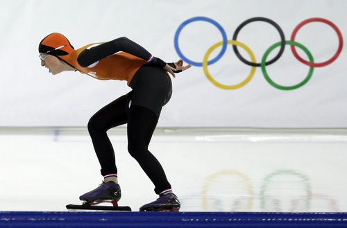 Annouk van der Weijden of the Netherlands competes in the women's 3,000-meter speedskating race at the Adler Arena Skating Center during the 2014 Winter Olympics, Sunday, Feb. 9, 2014, in Sochi, Russia. (AP Photo/Pavel Golovkin)