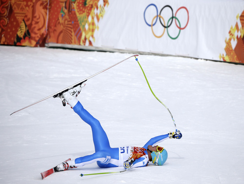 Italy's Christof Innerhofer celebrates after finishing the men's downhill of the Sochi 2014 Winter Olympics, Sunday, Feb. 9, 2014, in Krasnaya Polyana, Russia. Innerhofer won the silver medal. (AP Photo/Gero Breloer)